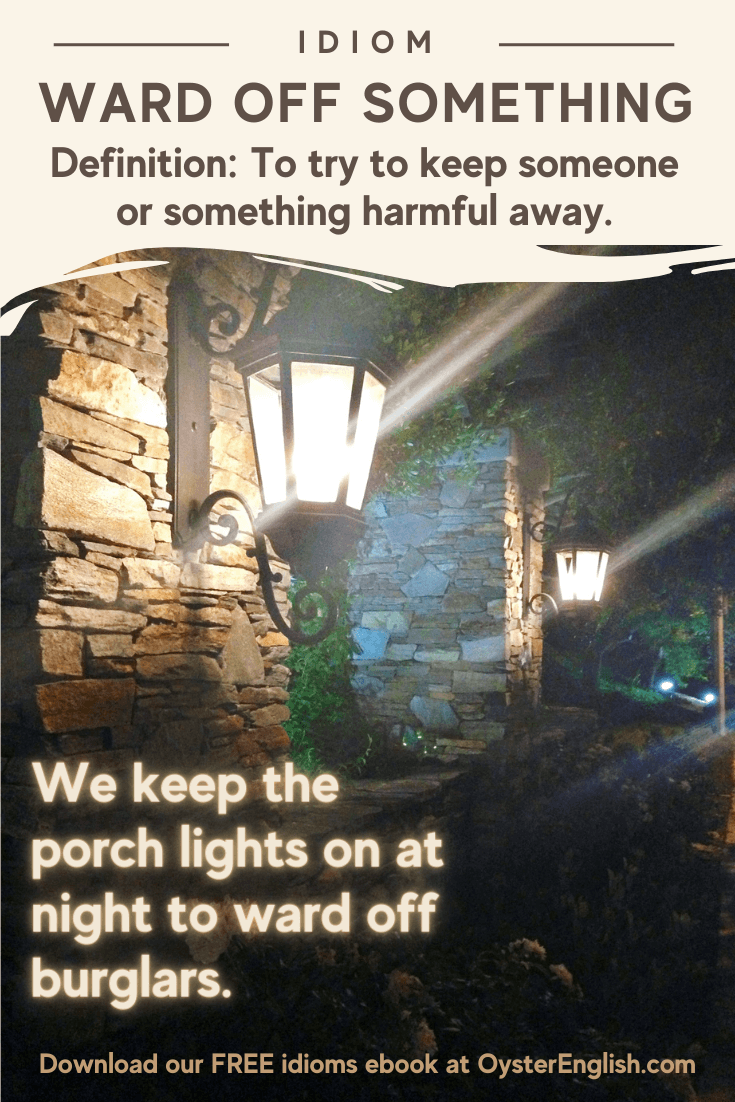 Image of a house with porch lights on at night: We keep our porch lights on at night to ward off burglars.