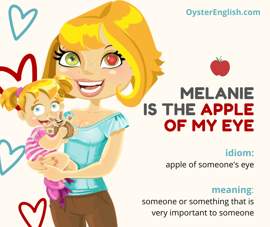 A smiling cartoon mother is holding her young child. The mother has a little red apple in the pupil of her eye. Caption: Melanie is the apple of my eye.