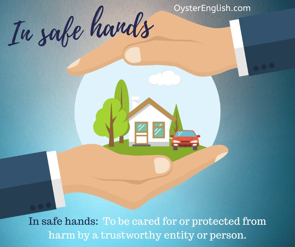 An image of a person holding a round globe in between his two hands protectively. A house and car are inside the globe. This depicts the idiom, in safe hands, which is defined on this page.