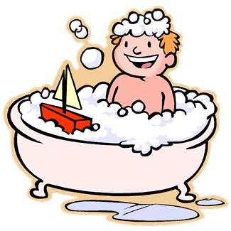 A boy takes a bubble bath