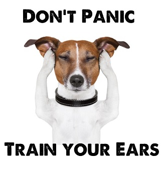 A white and brown Jack Russell dog covering his ears and closing his ears as if in distressed. Captioned