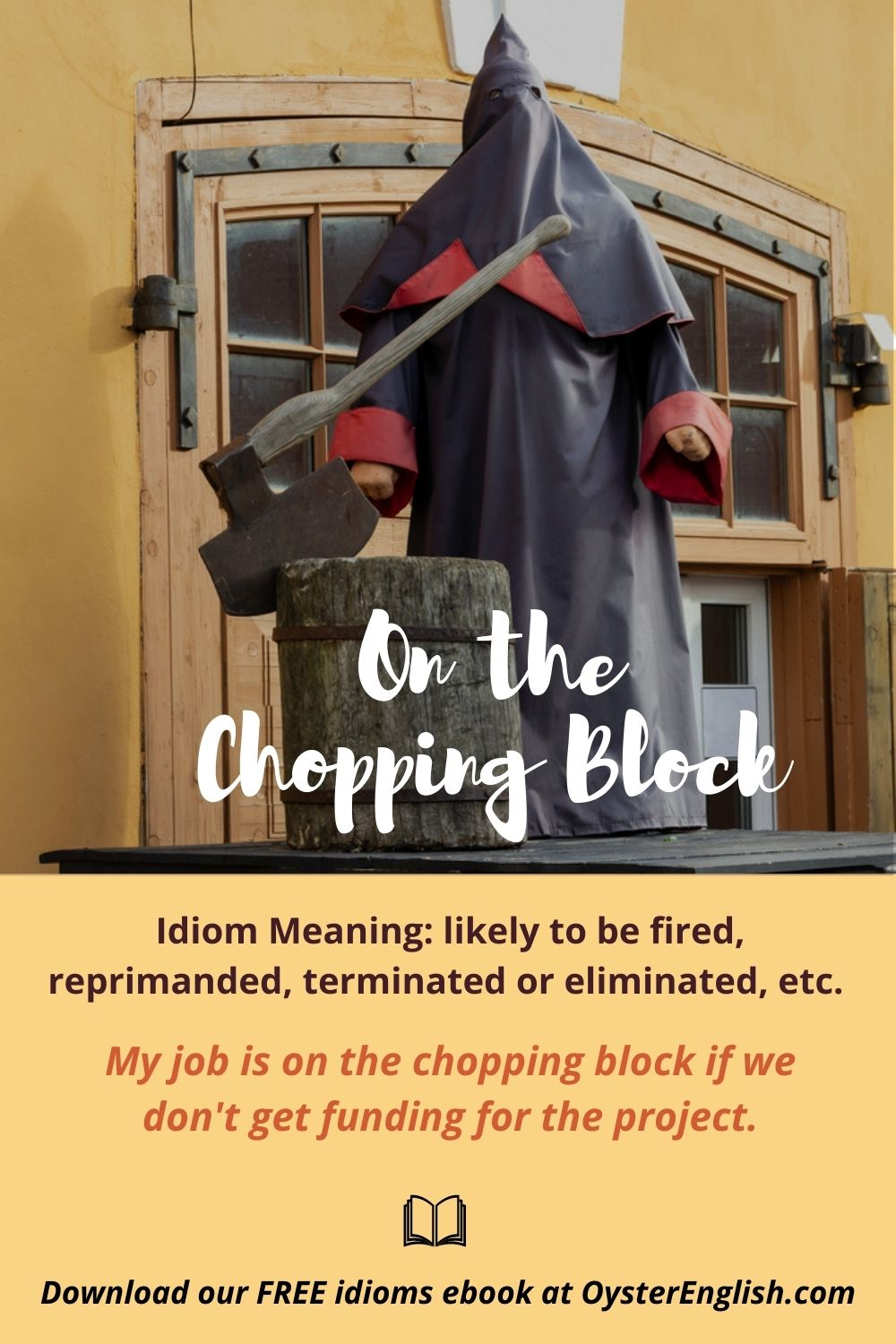 A Medieval executioner, wearing a hooded cloak, stands at a chopping block that has a huge ax in it. Caption: My job is on the chopping block if we don't get funding for the project.