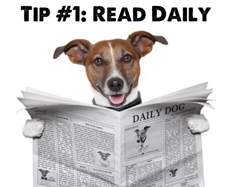 A dog is reading a newspaper (Tip #1: Read daily)
