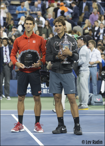 Picture of 2013 US Open tennis finalists, Rafael Nadal (the champion) and Novak Djokovic (runner-up) holding their trophies.