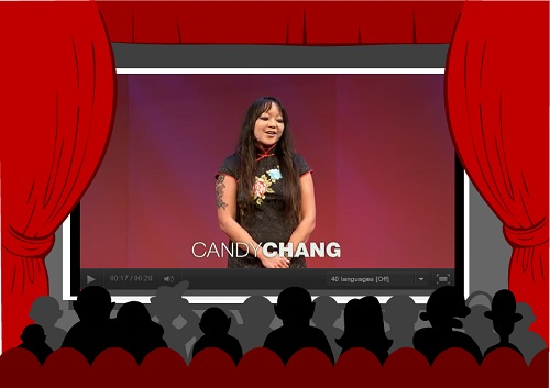 Candy Chang speaking on stage in front of audience