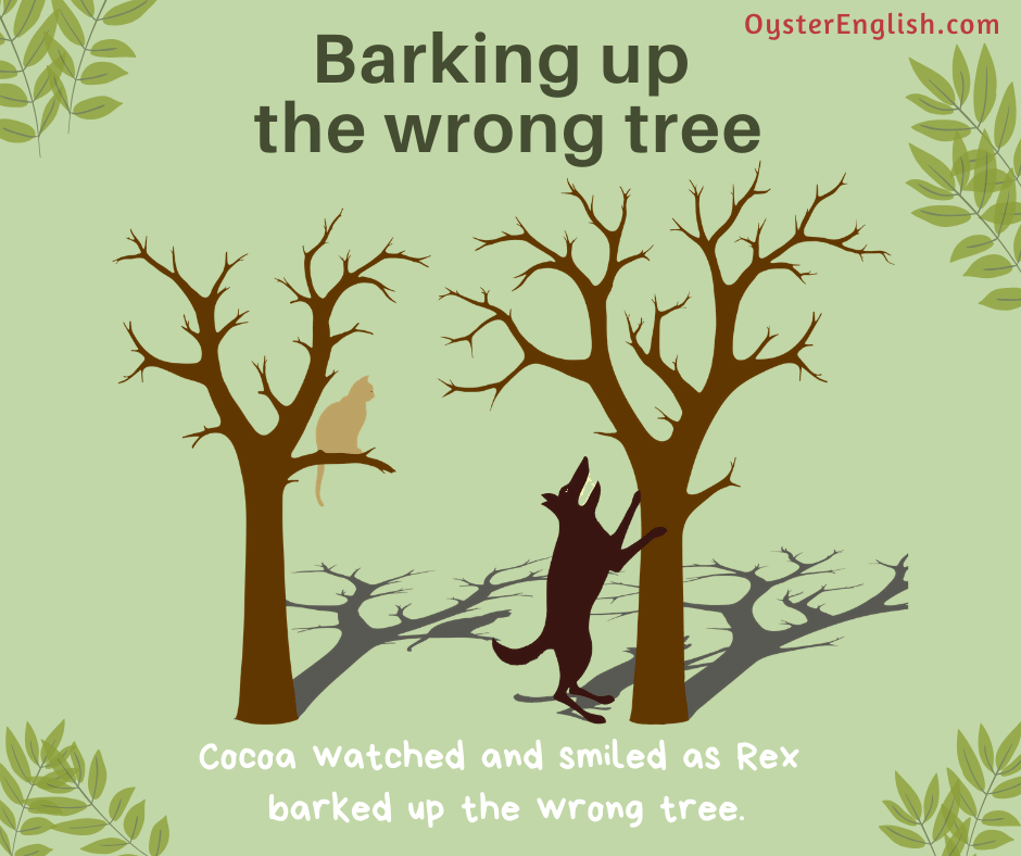 Illustration of a dog standing at tree and barking at it but a cat is sitting in another tree. Caption: Cocoa watched and smiled as Rex barked up the wrong tree.